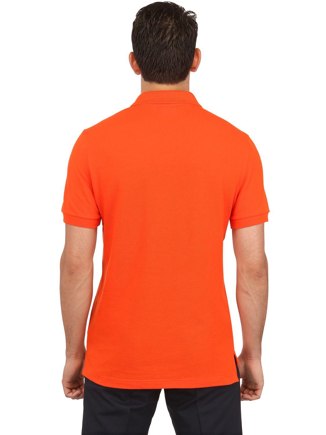Lyst lacoste petit piqu polo shirt in orange for men for Orange polo shirt mens