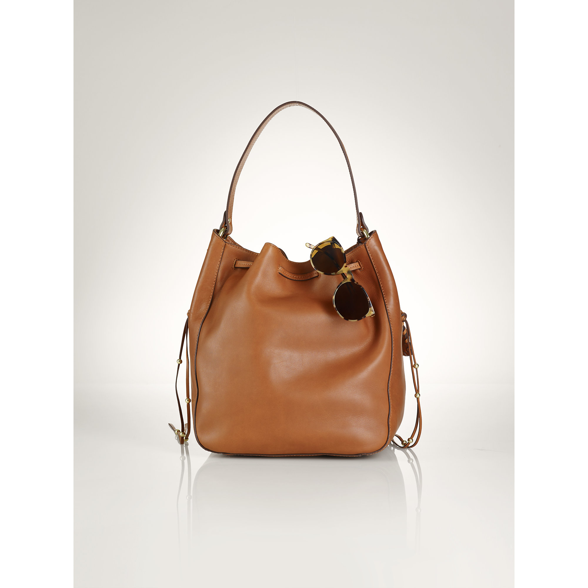 7a92c8a23d88 Lyst - Polo Ralph Lauren Laced Leather Drawstring Bag in Brown
