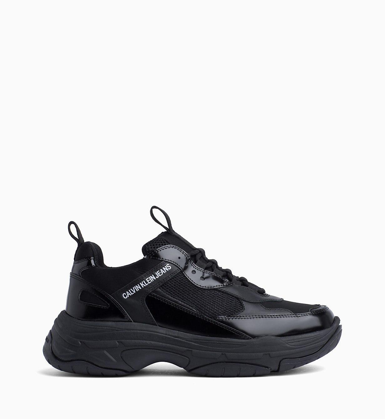 c6a4852454fe96 ... Black Leather Trainers. Visit Calvin Klein. Tap to visit site