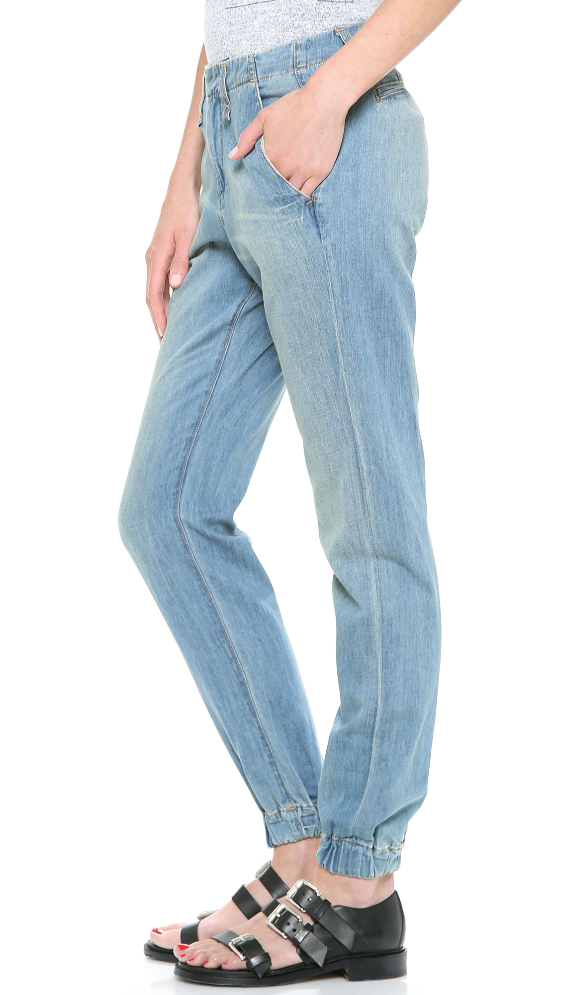 French terry Rag & Bone/JEAN lounge pants marry comfort with edge in a realistic, distressed denim trompe l'oeil print. Covered elastic cuffs. On-seam hip pockets. Elastic waistband. Fabric: French terry. % cotton. Wash cold. Made in Japan.