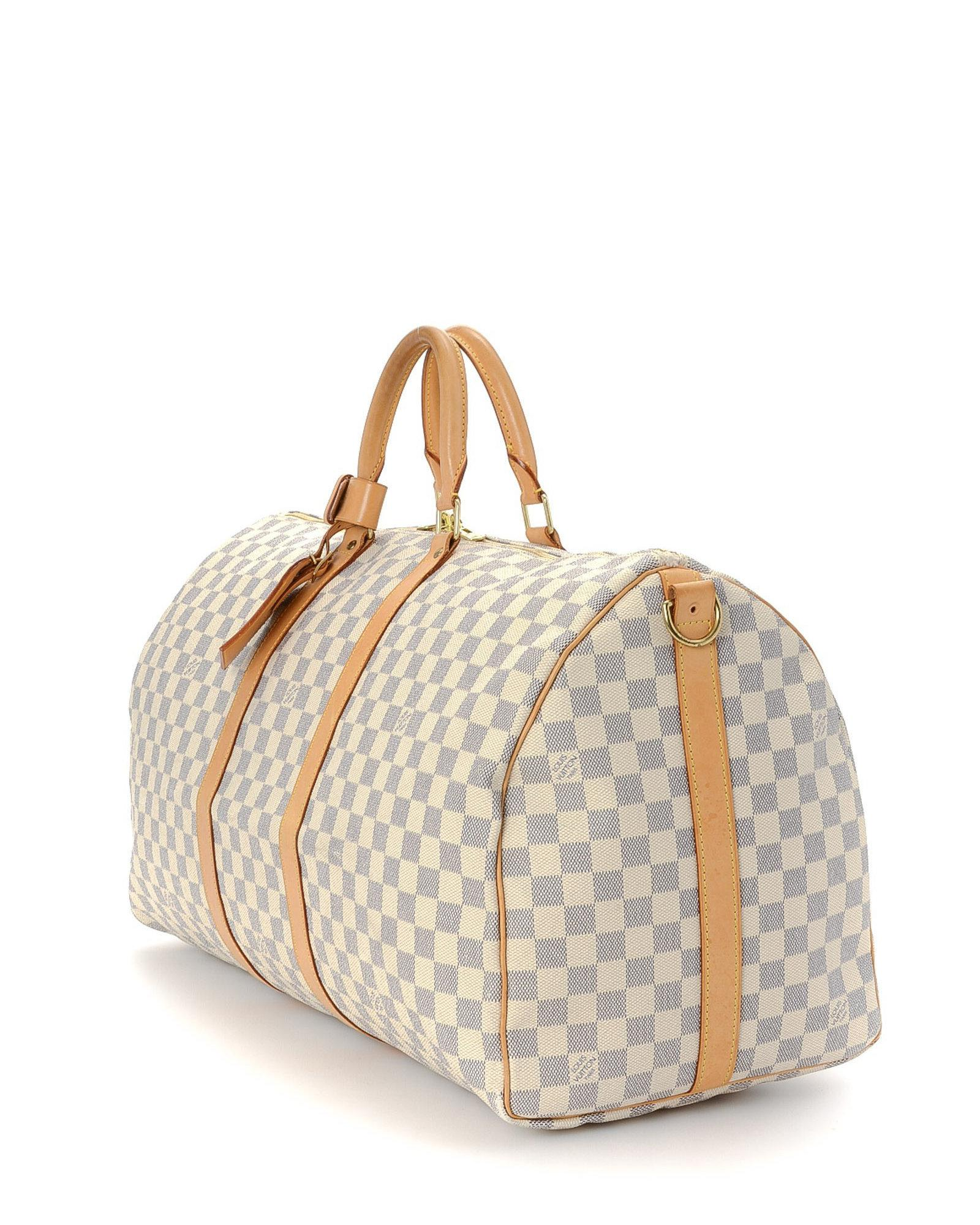 74f7ed3f2a5d Louis Vuitton Keepall Bandoulière 55 Travel Bag - Vintage in White - Lyst