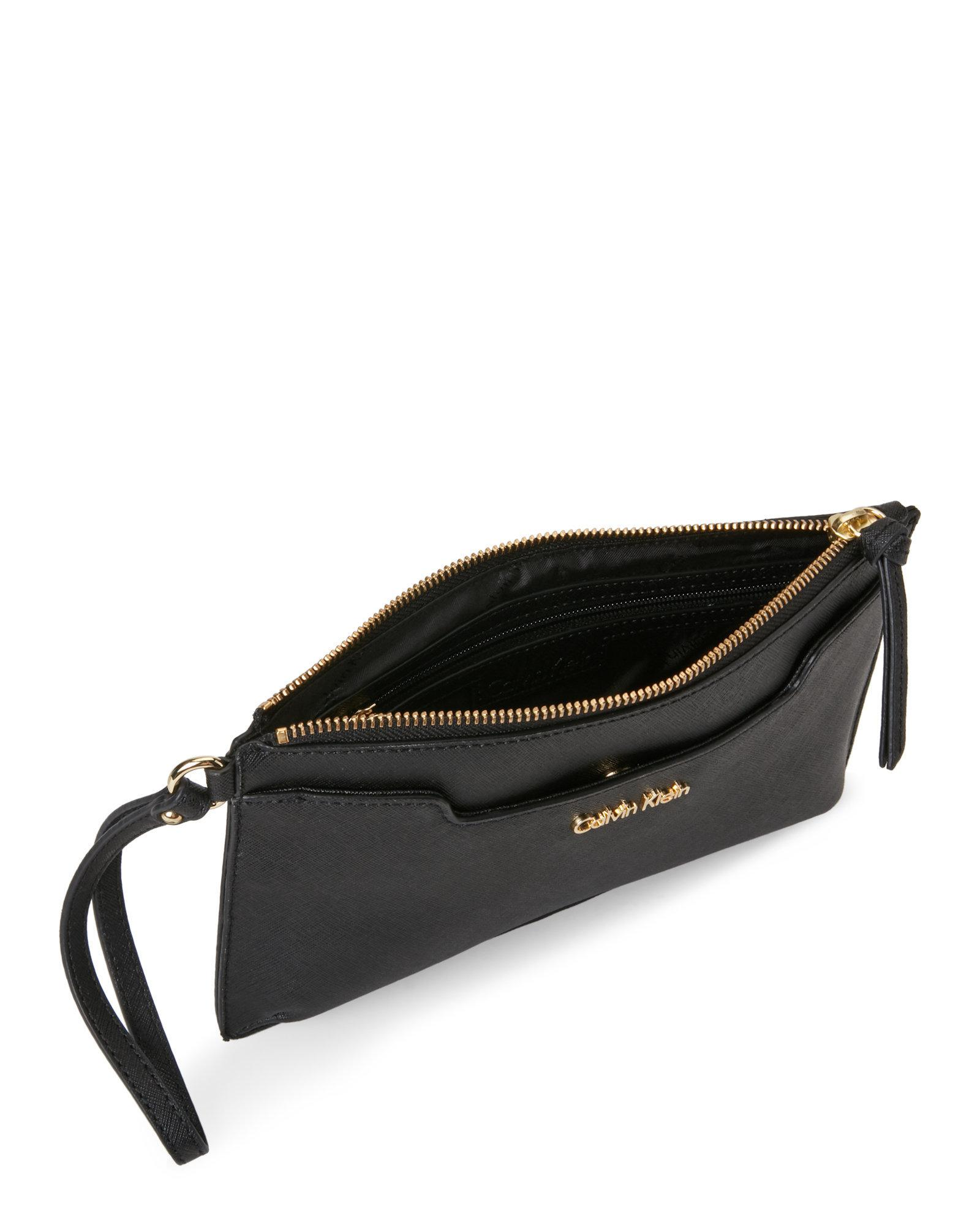 21ba901ad9 Calvin Klein Black Saffiano Leather Wristlet in Black - Lyst