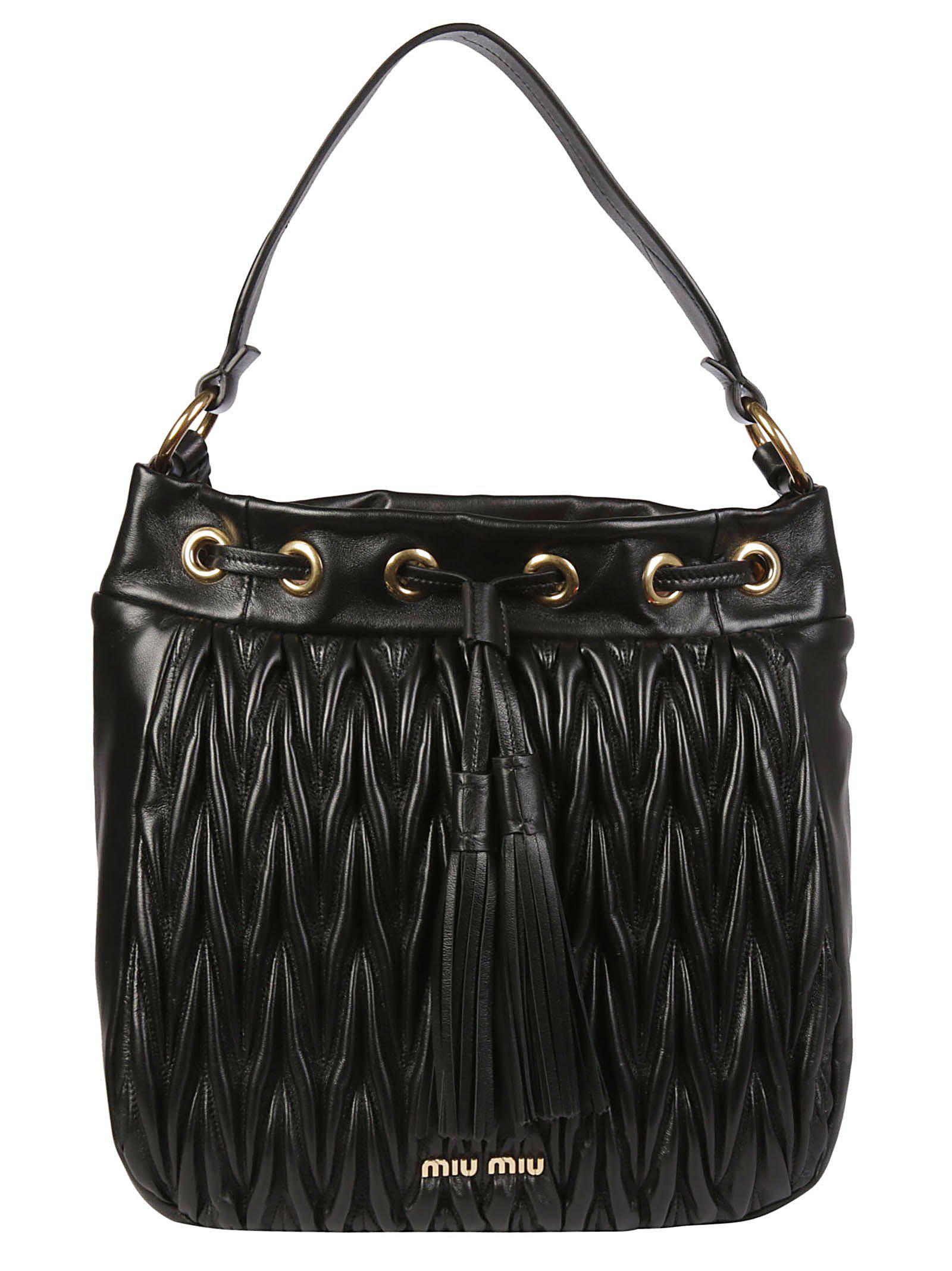 78aba779a105 Lyst - Miu Miu Matelassé Tassel Tote Bag in Black