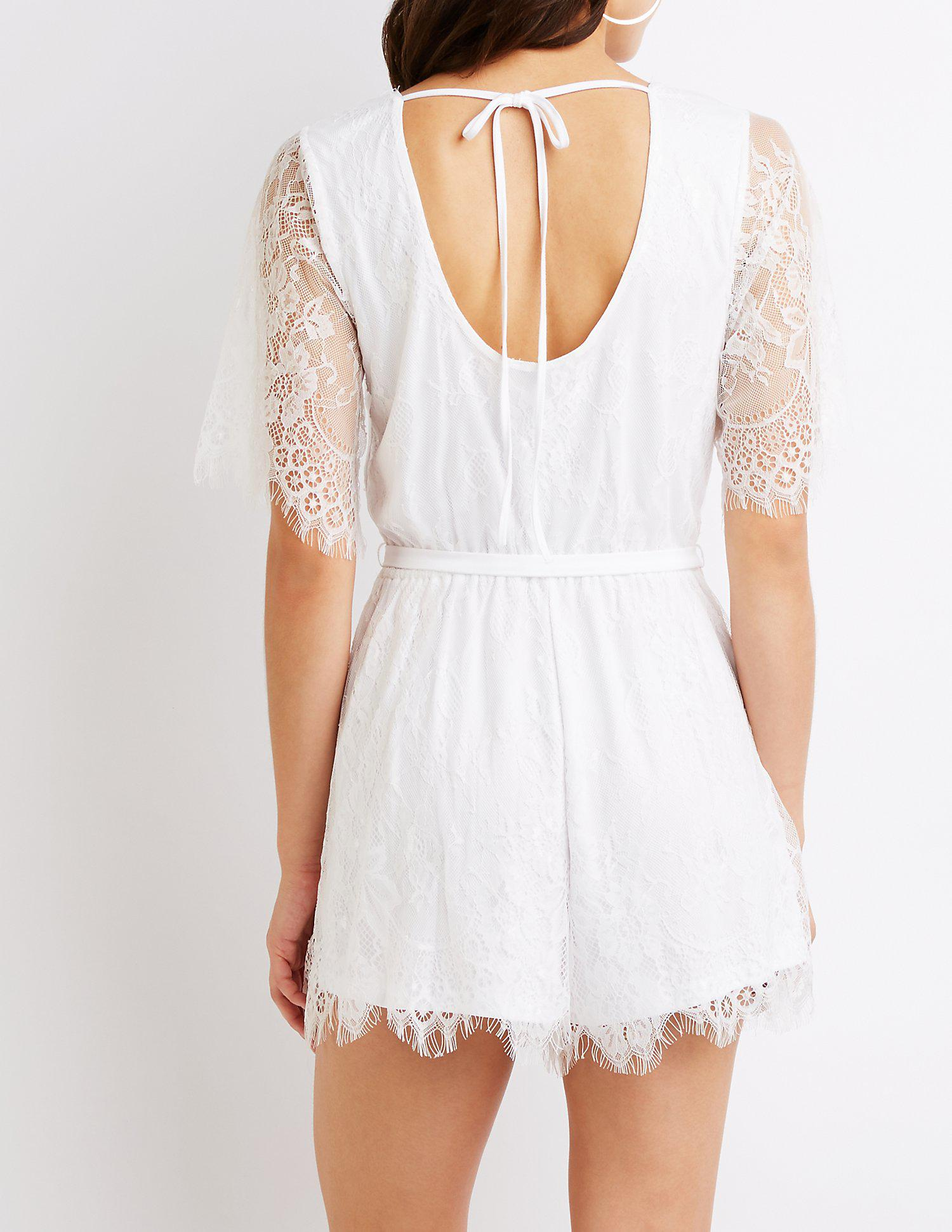 95f0b6adc594 Charlotte Russe - White Floral Lace Wrap Romper - Lyst. View fullscreen
