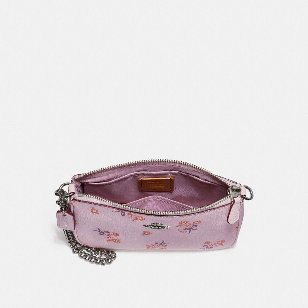 b85e795b68222 ... promo code coach pink nolita wristlet 19 with floral bow print lyst.  view fullscreen 8ca66