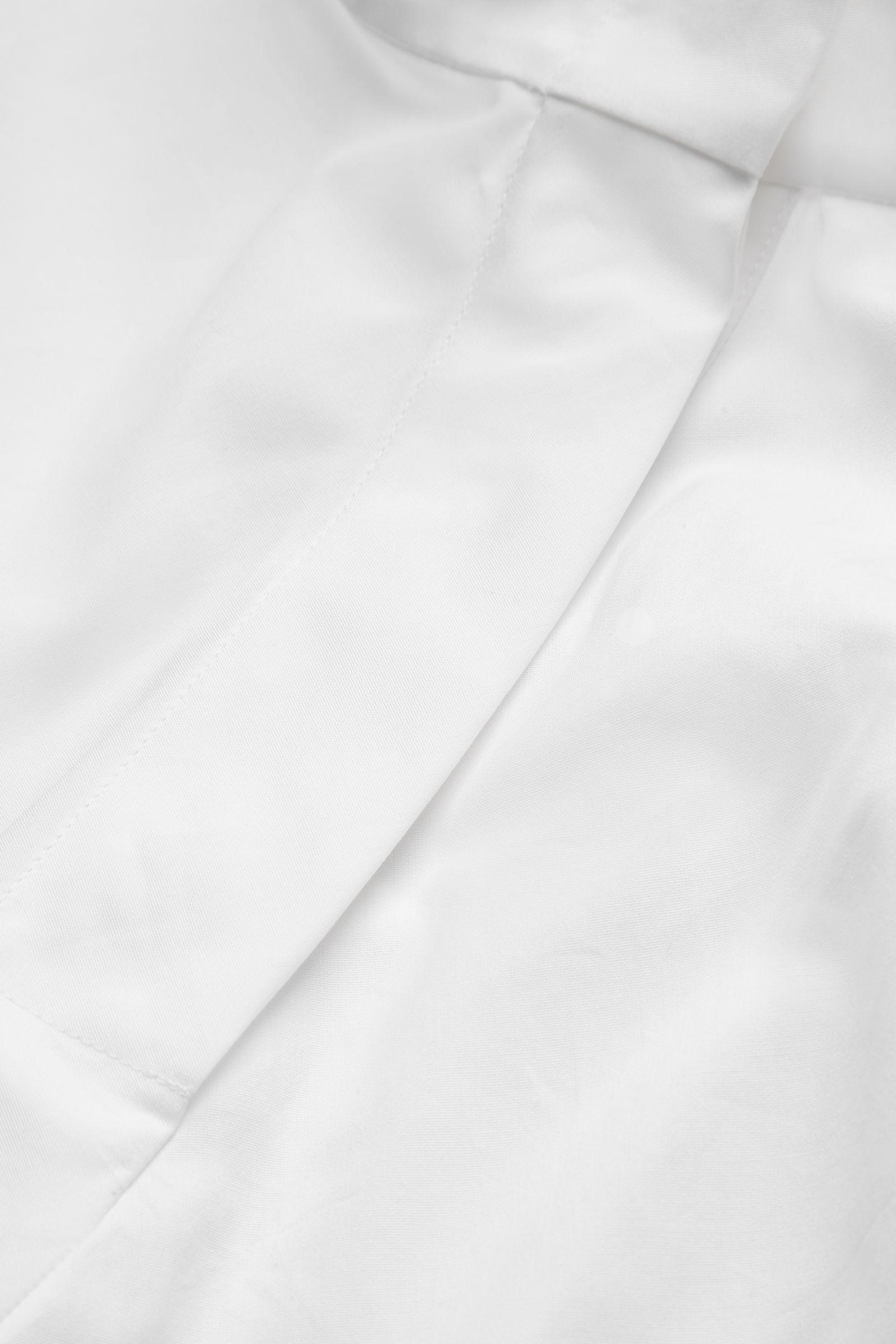 e28171dfbdb9 COS High-neck Asymmetric Blouse in White - Lyst