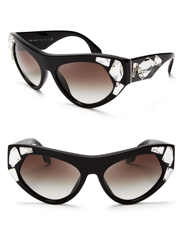 e0a0301eca52 Lyst - Prada Oversized Crystal Cat Eye Sunglasses in Black