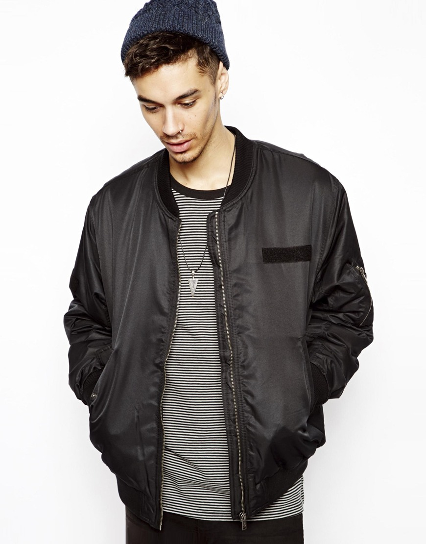 USA Leather Classic Mens Leather Bomber Jacket The USA Leather Classic Bomber Jacket looks appropriate absolutely anywhere and features soft touch leather, elastic waist, zipper and snap front closure with zipout pile lining, 2 side pockets and snap cuff.