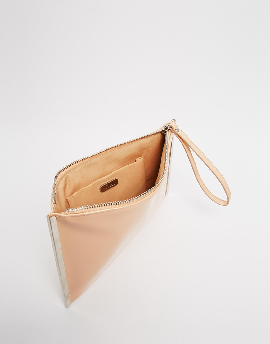 5f3f47685 Faith Patent Nude Clutch Bag With Metal Bar Side Detail in Natural ...