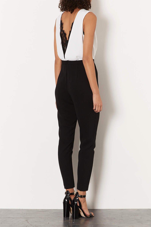 e22f38ef2103 Lyst - TOPSHOP Petite Lace Back Jumpsuit in Black