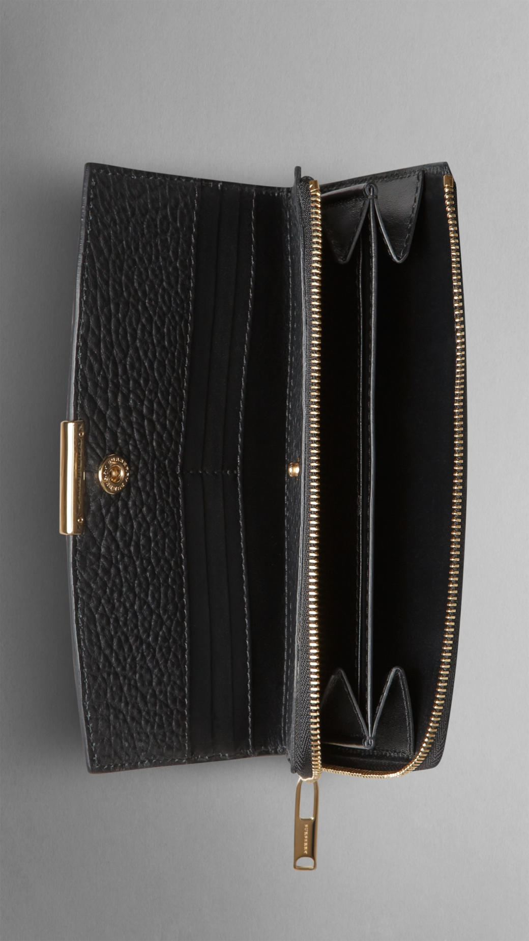 Burberry Embossed Check Leather Ziparound Wallet In Black