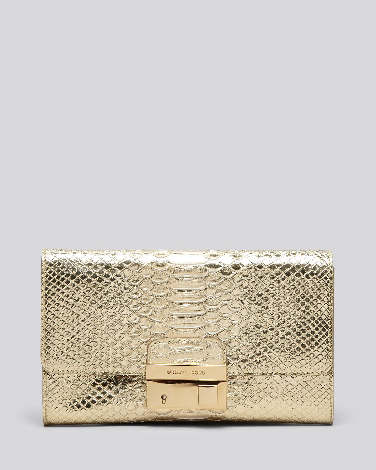 6ce62340263c21 Michael Kors Clutch Gia Embossed with Lock in Metallic - Lyst