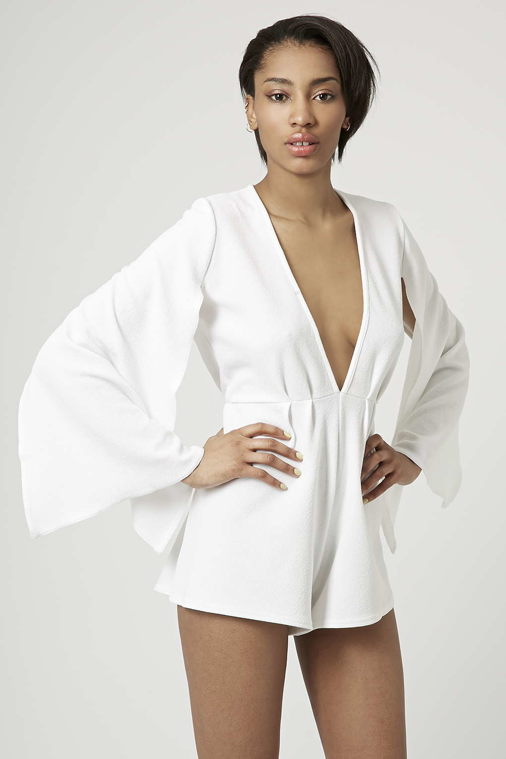 c5aae31ecdac TOPSHOP Cape Sleeve Plunge Playsuit By Rare in White - Lyst