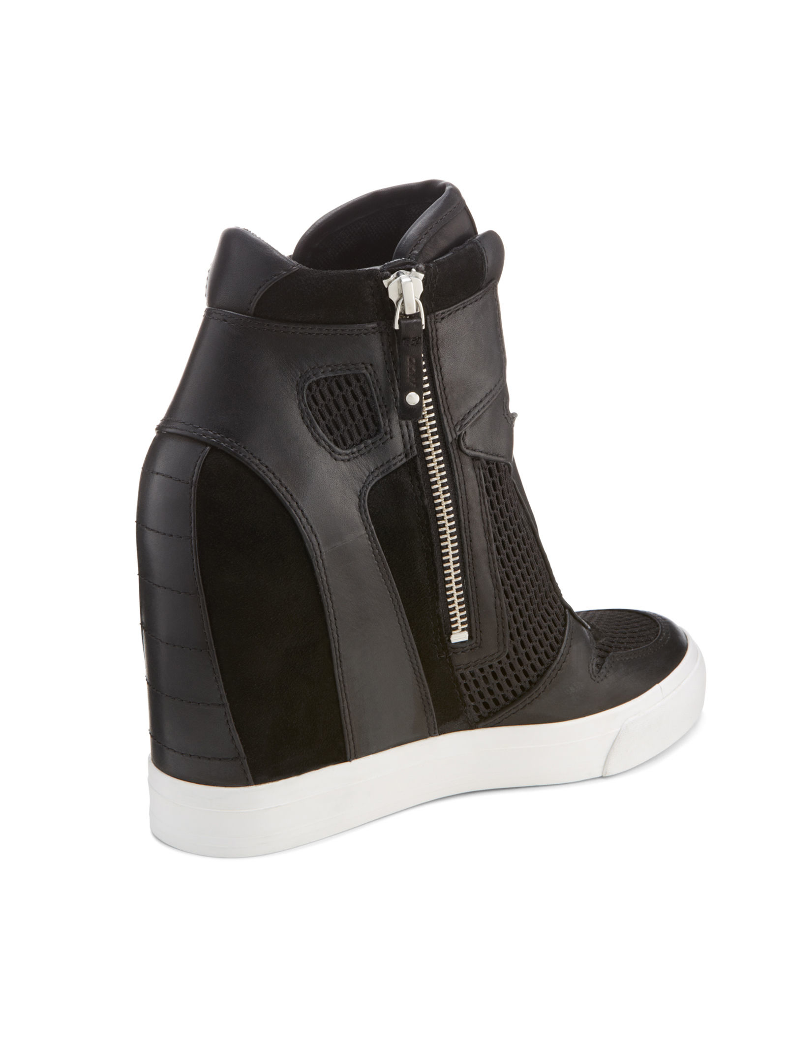 9e7d58bd5386 Lyst - DKNY Grand Wedge Sneaker in Black