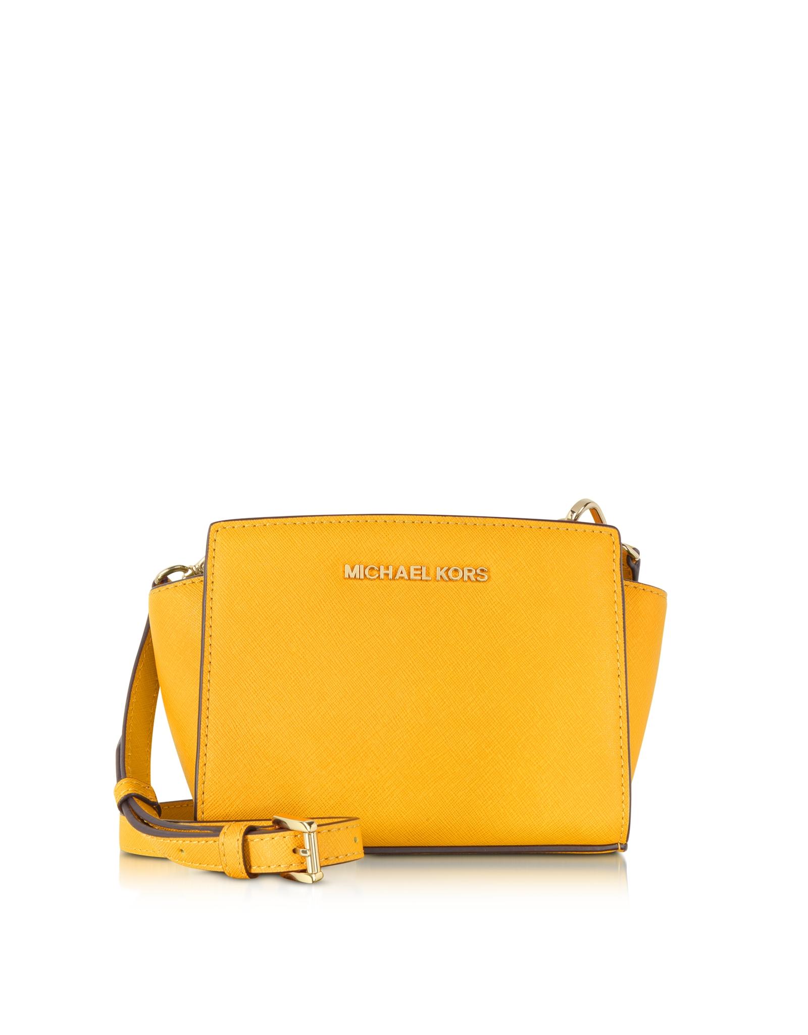 7a9b549f1196 Lyst - Michael Kors Selma Saffiano Leather Mini Messenger in Yellow