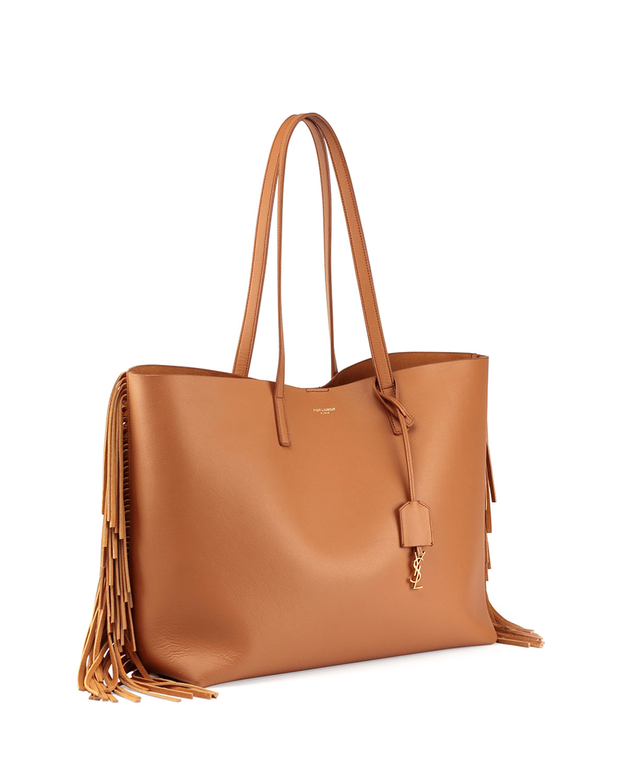 97147ac5c2 Lyst - Saint Laurent Large Calfskin Fringe Shopping Tote Bag in Brown