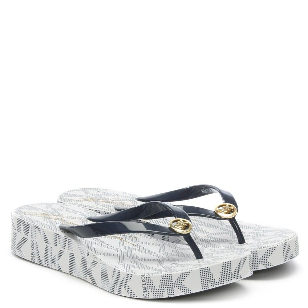 0471769e7ad Lyst - Michael Kors Bedford Navy Logo Toe Post Platform Flip Flops ...