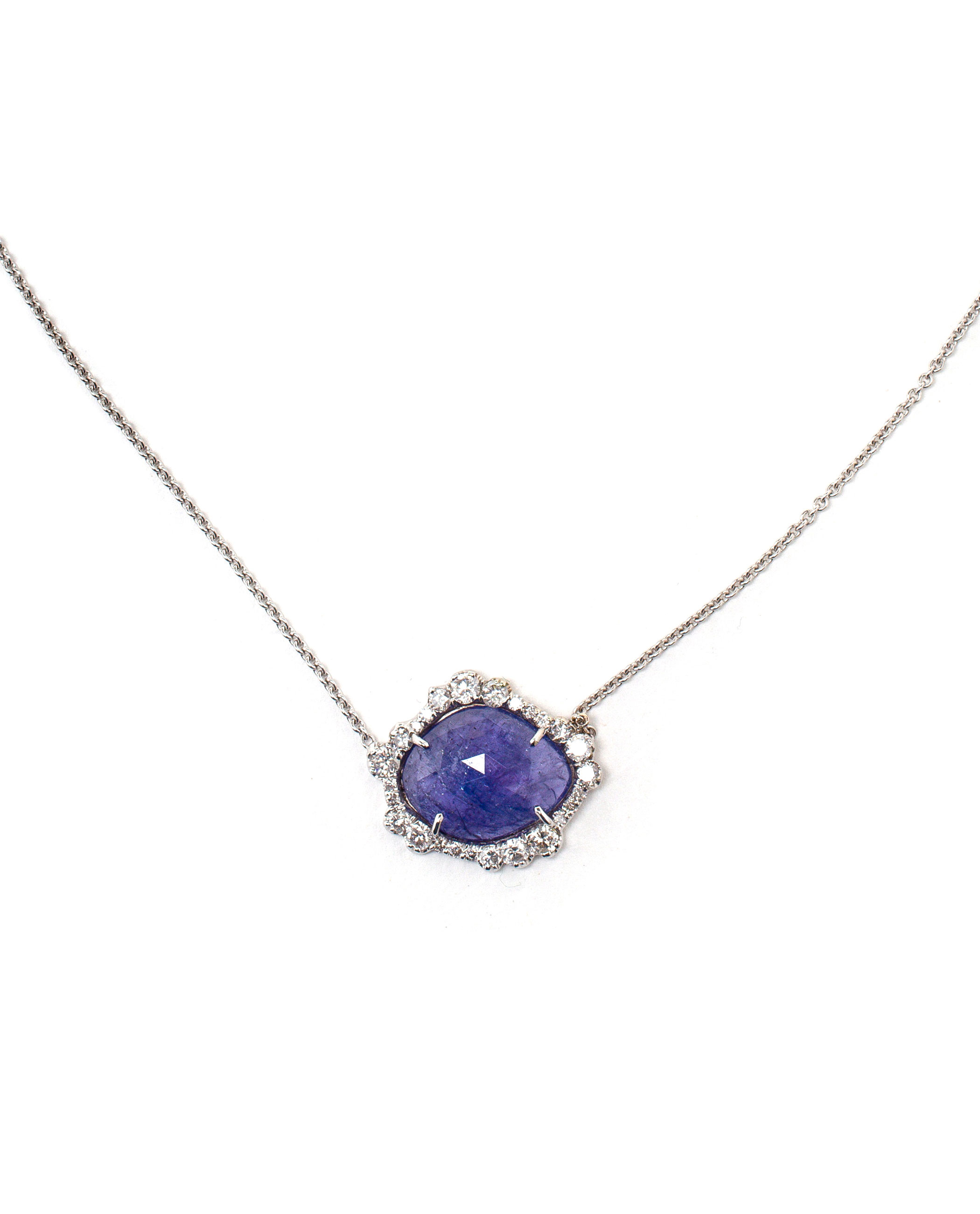 accents cabochon a white the with tanzanite karat chain pendant from pin an necklace diamond sapphires and hangs gold accented