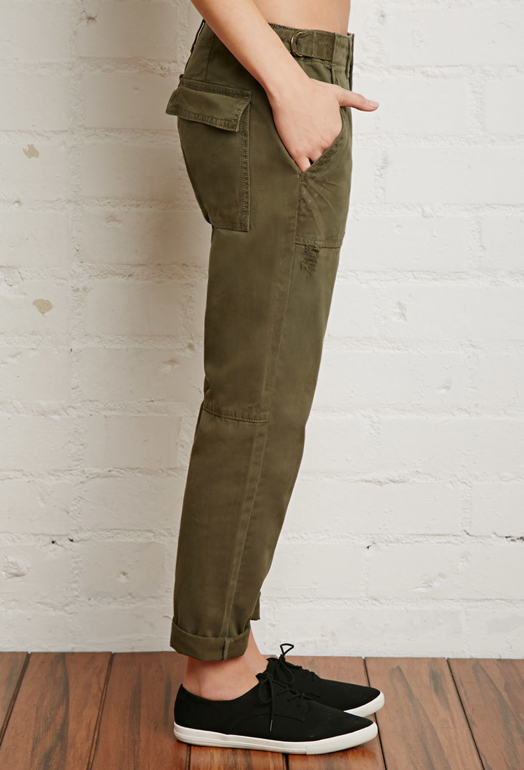 This pair of woven cargo pants features a capri cut, skinny fit, cargo pockets, button-cuffed legs, back patch pockets, front slanted pockets, a zip fly, and mid-rise sell-lxhgfc.ml: $