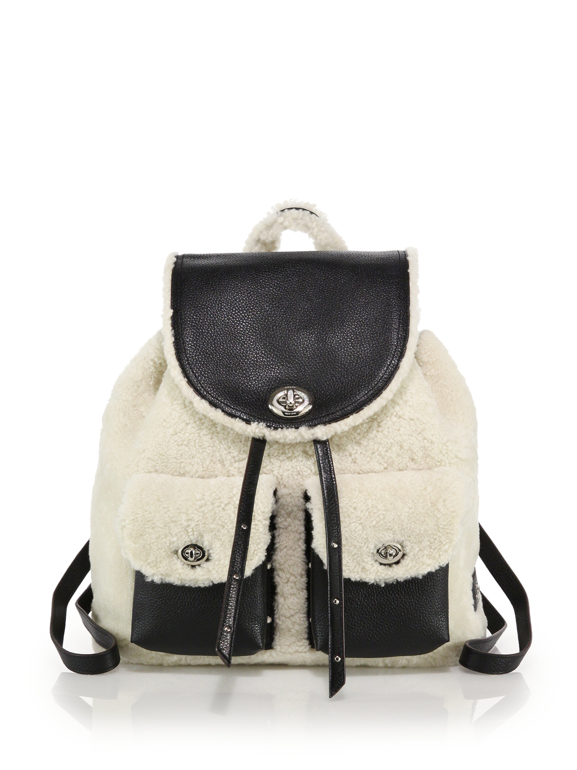 6a2ff7eec93e ... order lyst coach shearling leather turnlock backpack in black 8199c  e568a