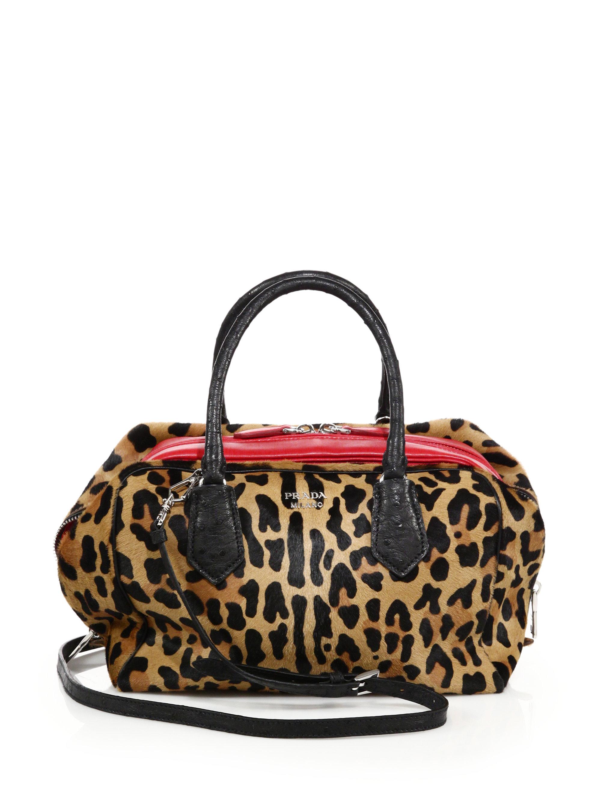 efb825e4837 ... wholesale lyst prada leopard print calf hair ostrich leather inside bag  9a48f 4c5c1