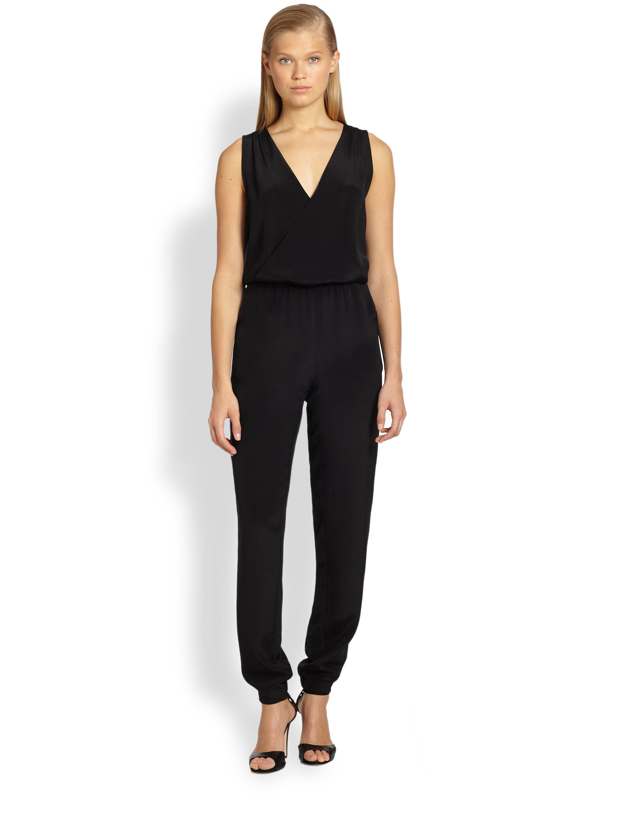 Standout in a sea of little black dresses in this slinky jumpsuit. Ribbing at the waistband and bodice provides shape, while elastic at the leg opening provides styling options.
