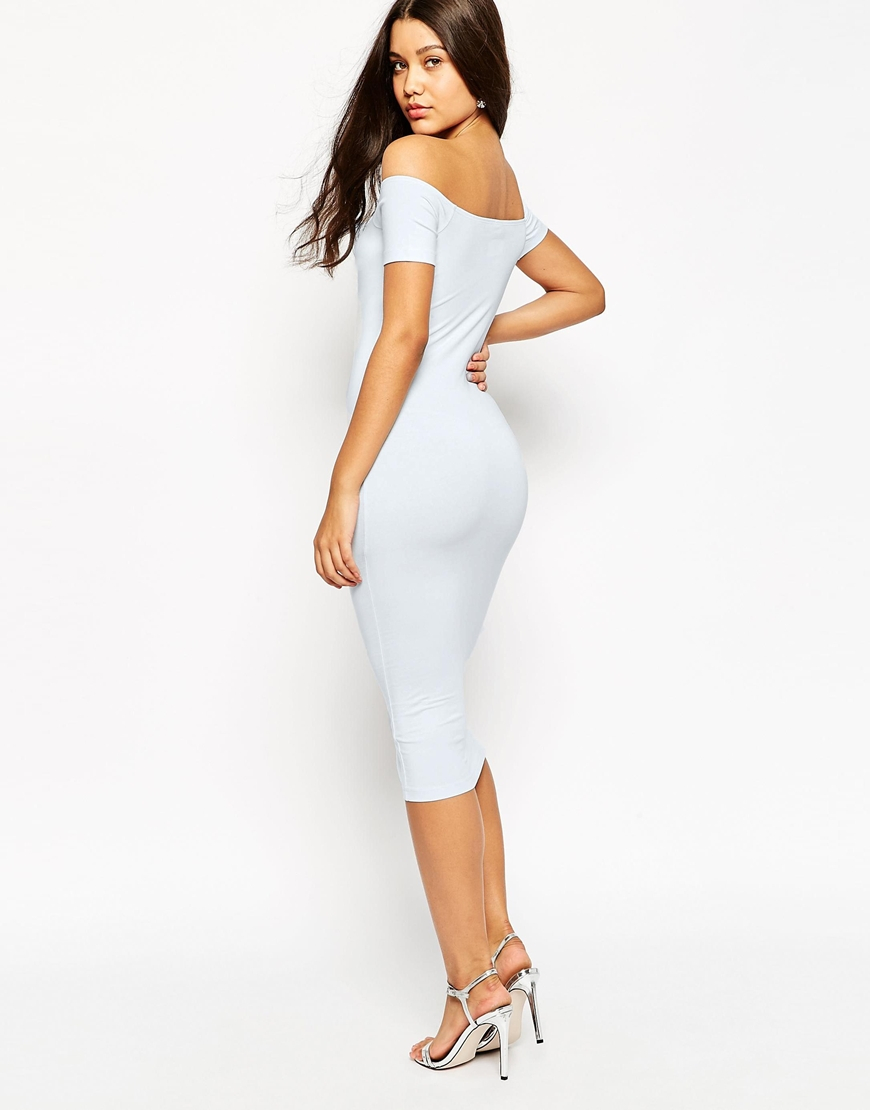 White bodycon dress with bell sleeves