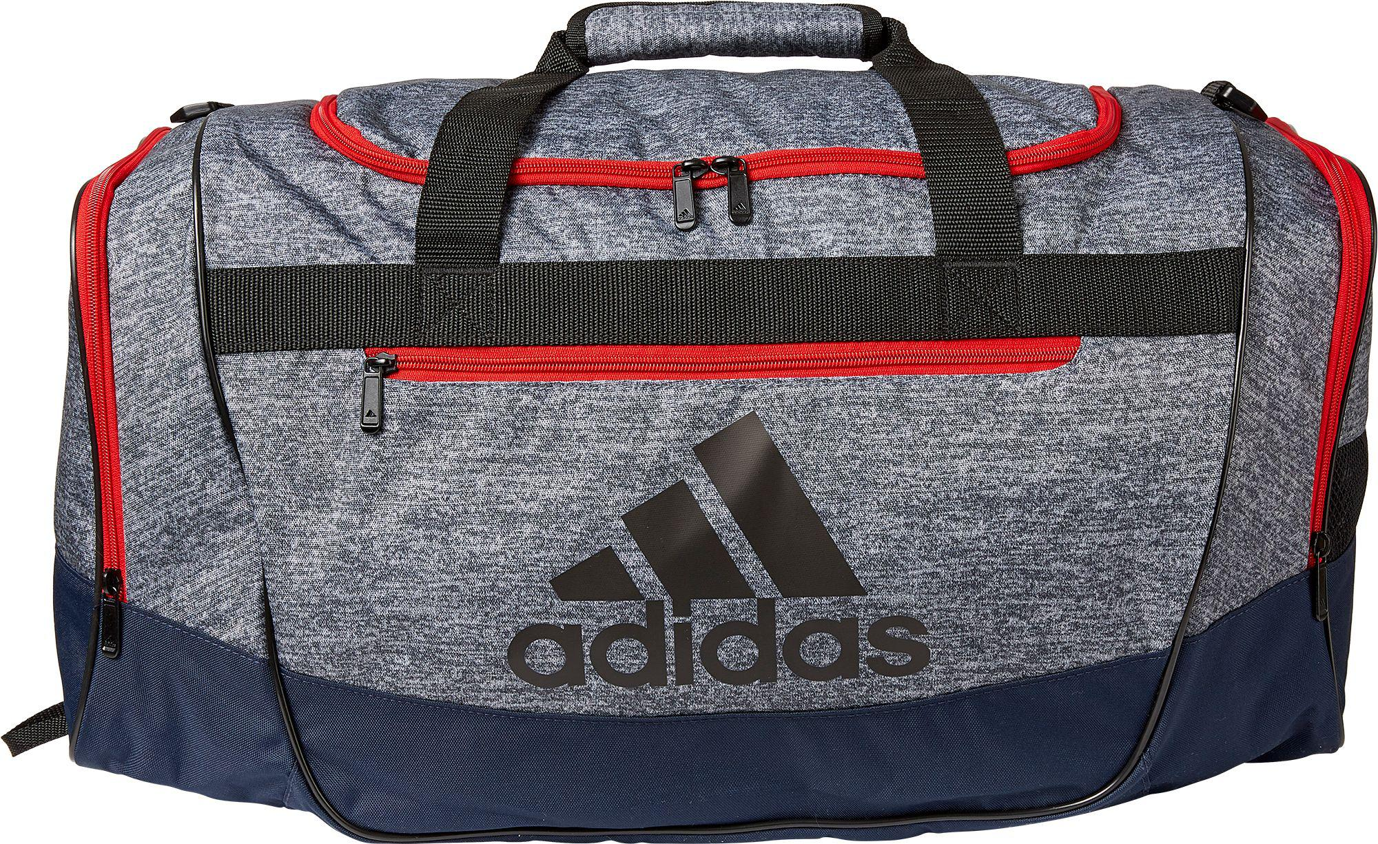 c1bbb1bd389f ... Defender Iii Medium Duffle Bag for Men - Lyst. View fullscreen