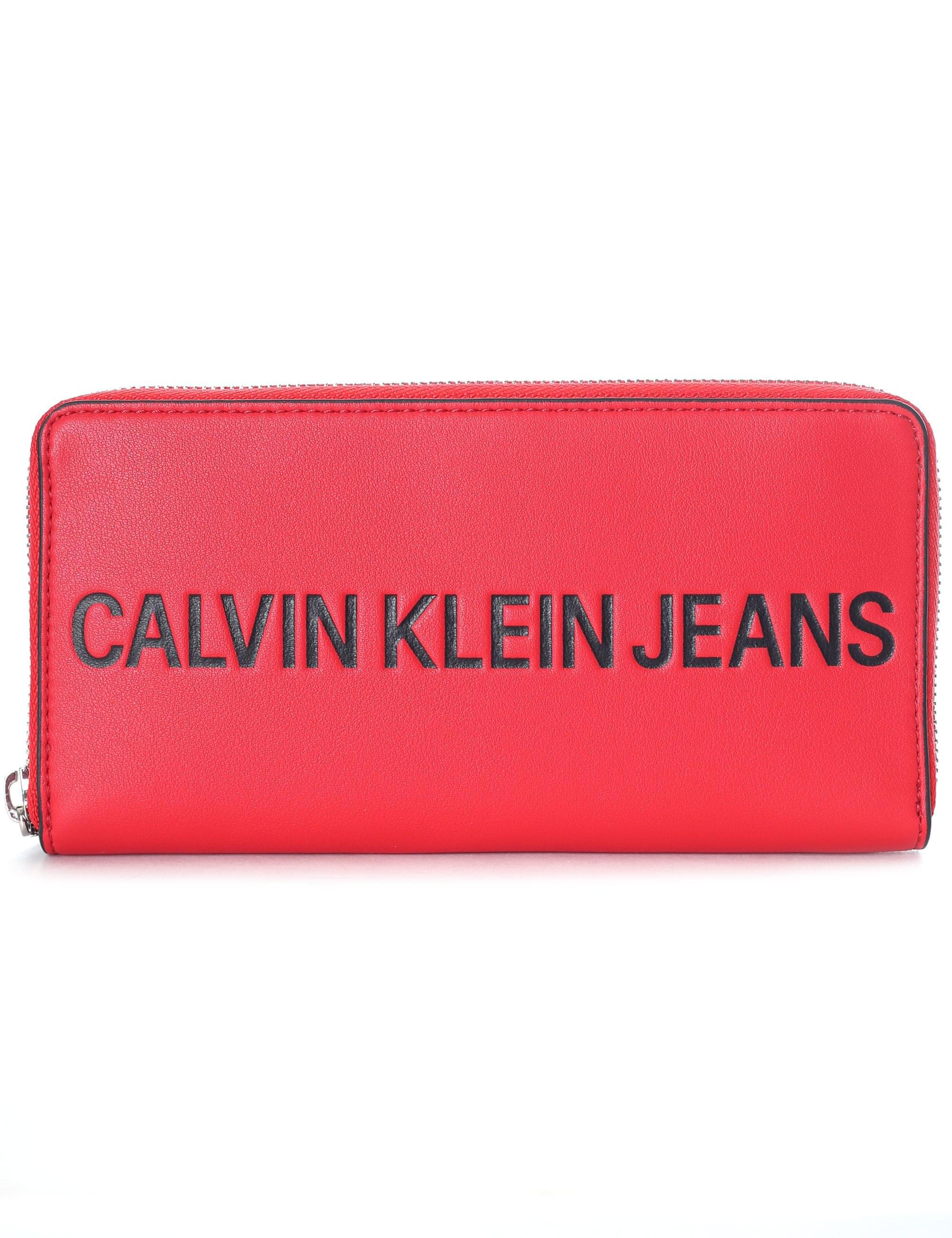 df33c6083ff Calvin Klein Logo Zip Around Purse in Red - Lyst