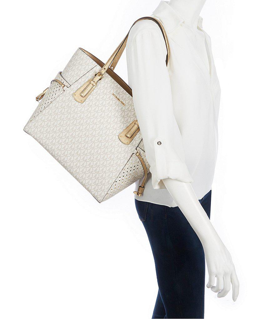 a09151edbac8ee ... uk lyst michael michael kors signature voyager east west tote in  metallic 97f36 8f8fe