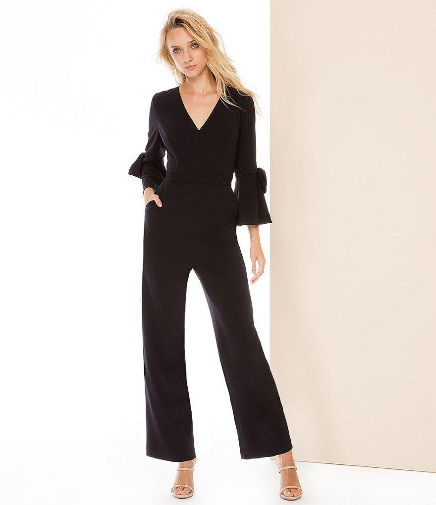 721e8deaa33 Donna Morgan V-neck Bow Detail Ruffle Sleeve Jumpsuit in Black - Lyst