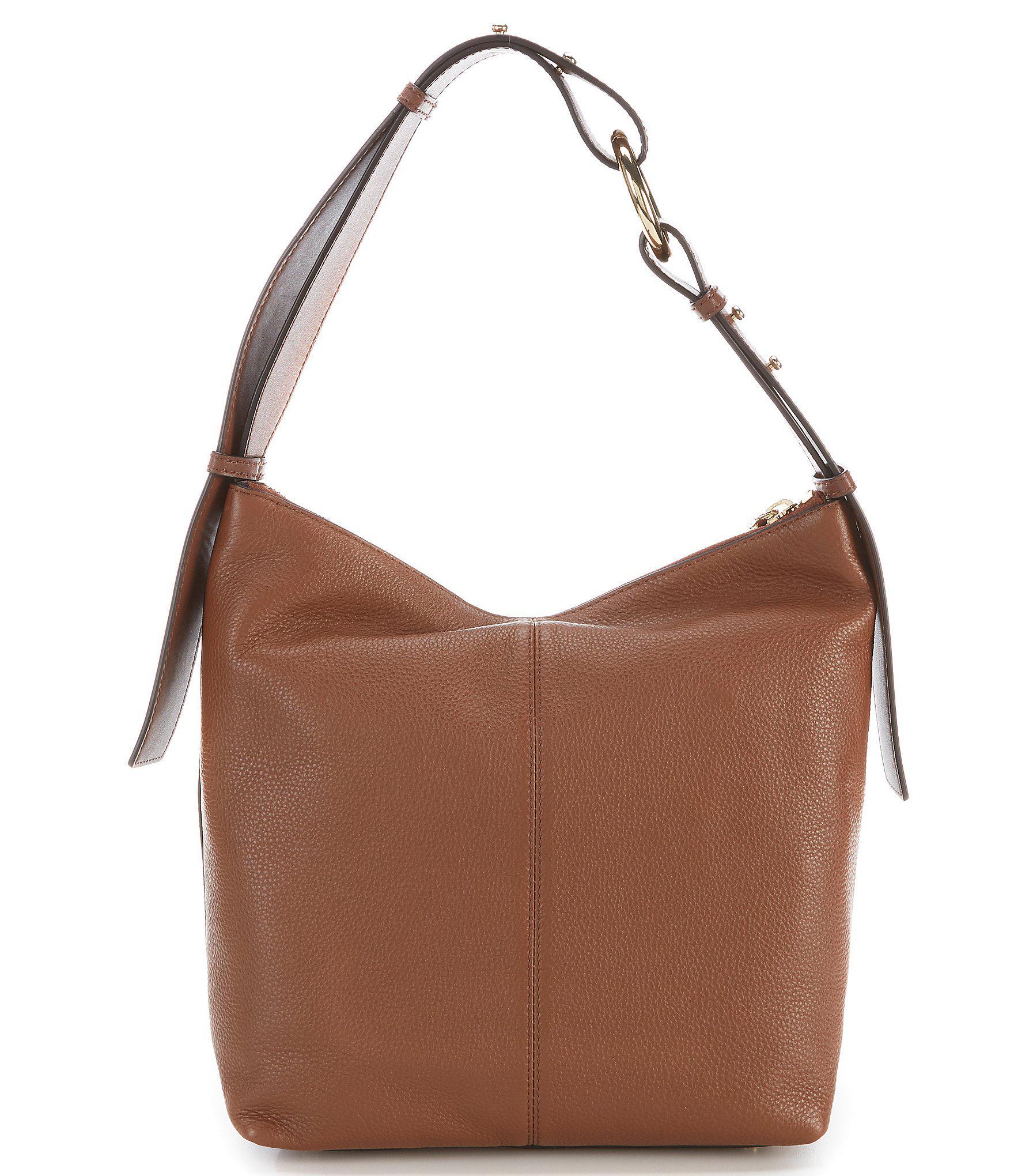 c42aff8fb675 Lyst - Calvin Klein Liana Pebble Hobo Bag in Brown