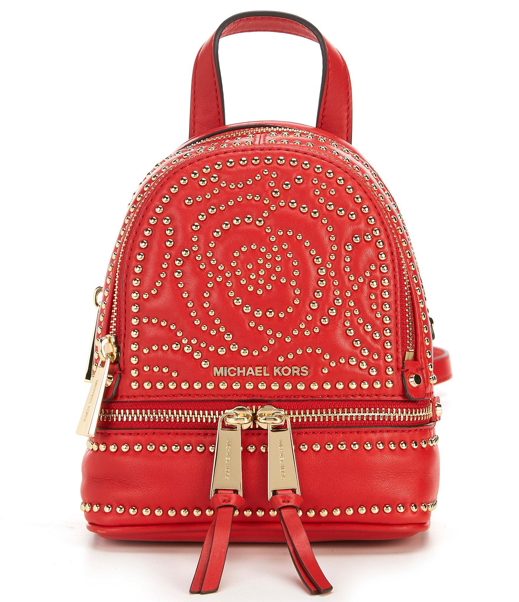 7ce1dcce511c Lyst - Michael Michael Kors Rhea Extra Small Messenger Backpack in Red