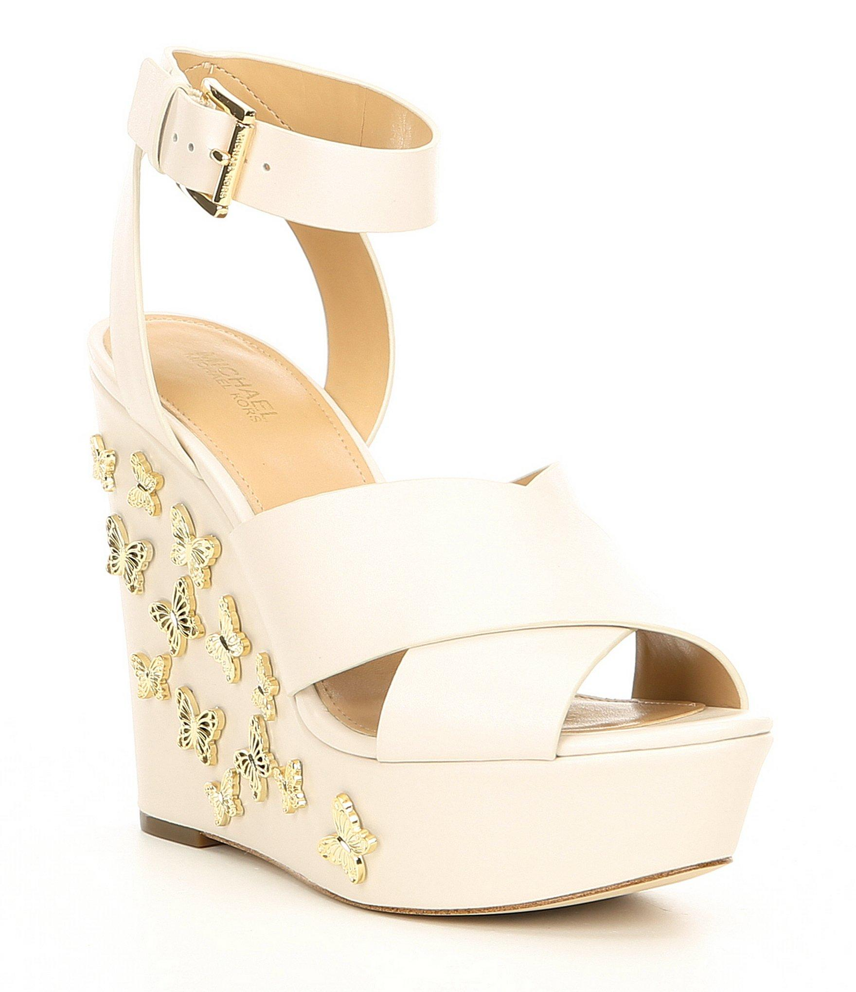 62e2faeacc12 MICHAEL Michael Kors. Women s Natural Lacey Leather   Butterfly Charm Wedge  Sandals