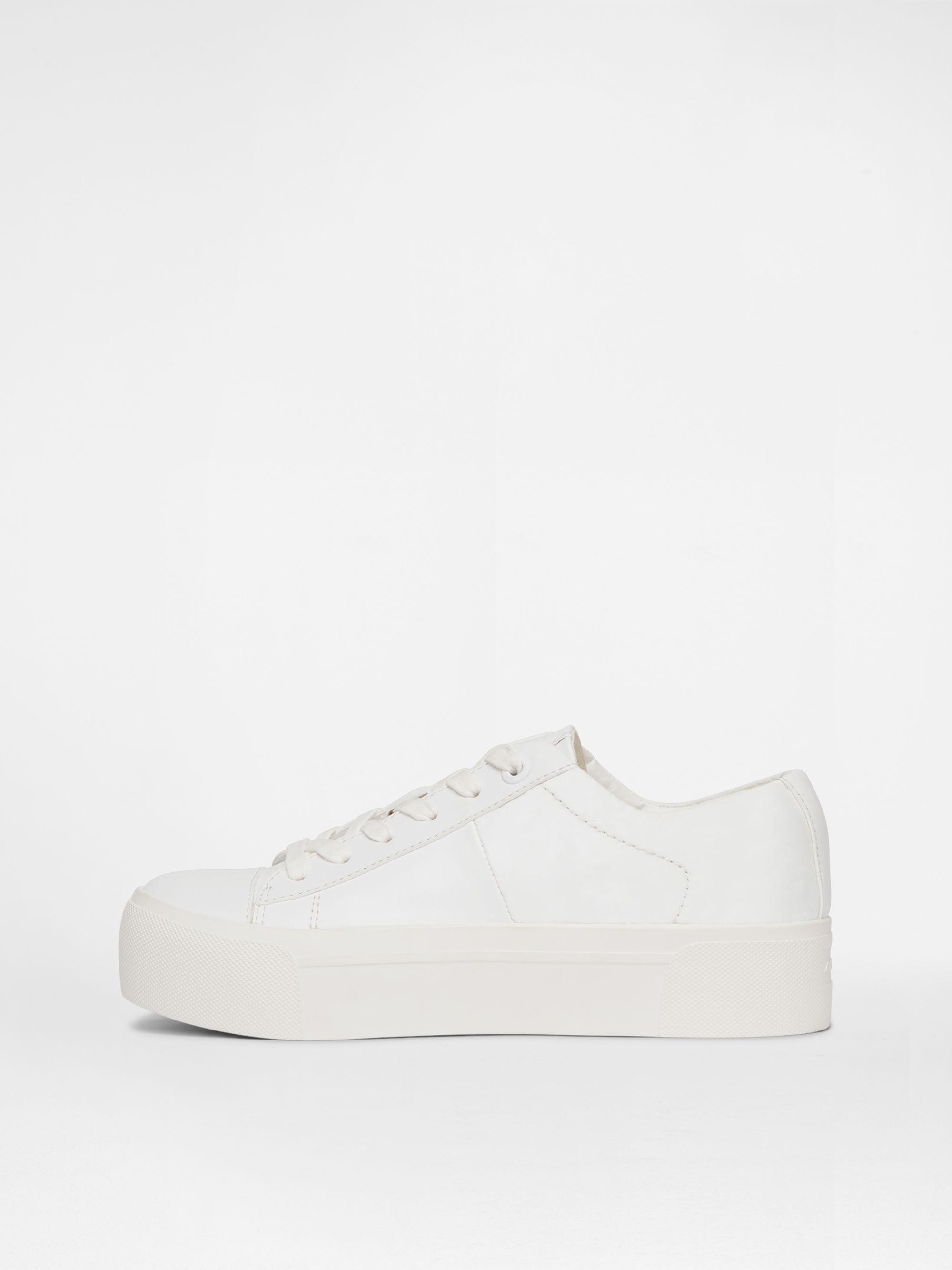 7b32a5d0484 Lyst - DKNY Bari Platform Sneaker in White