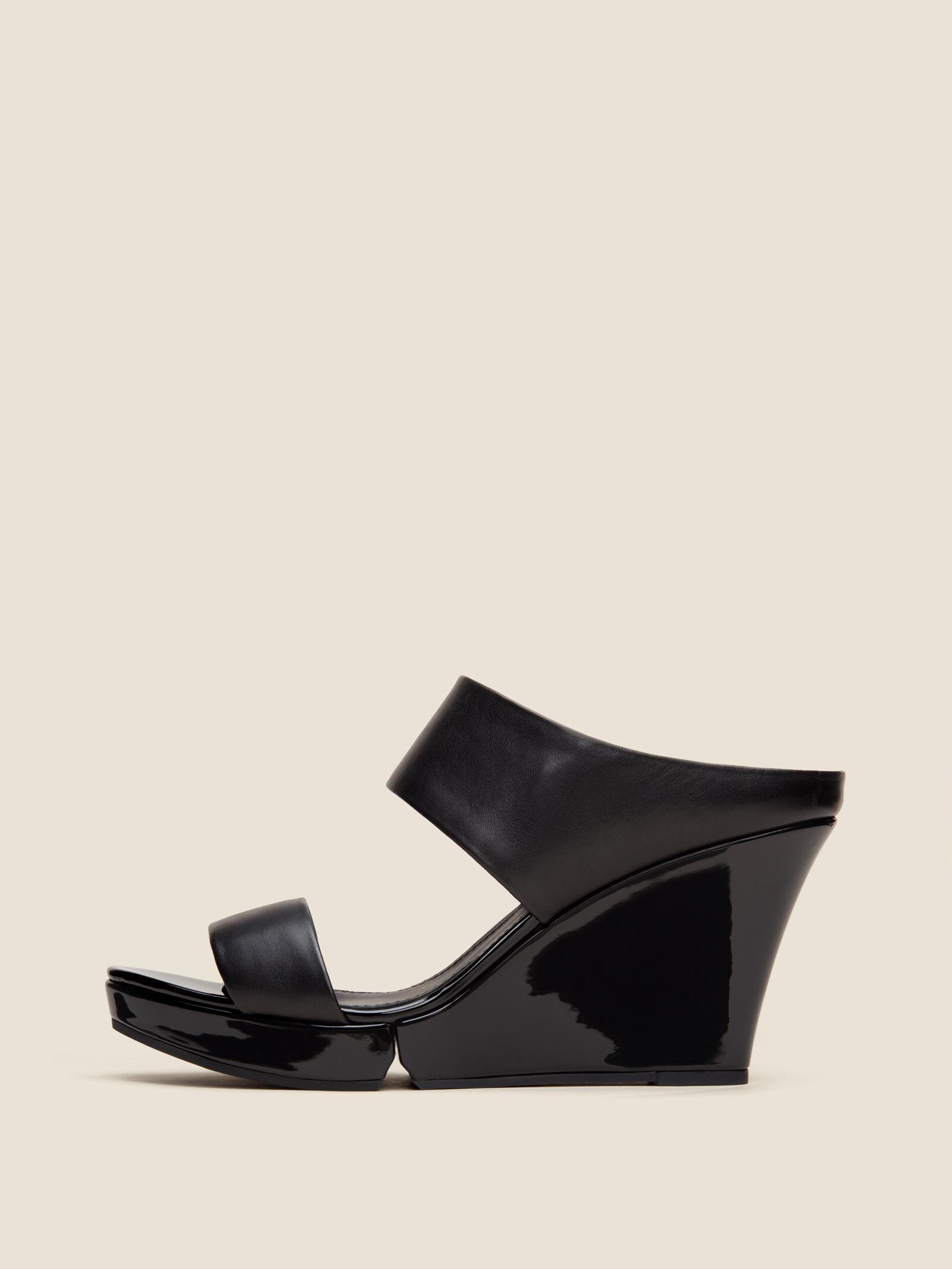 2fbf47639c4f Lyst - Dkny Kami Leather Wedge Sandal in Black