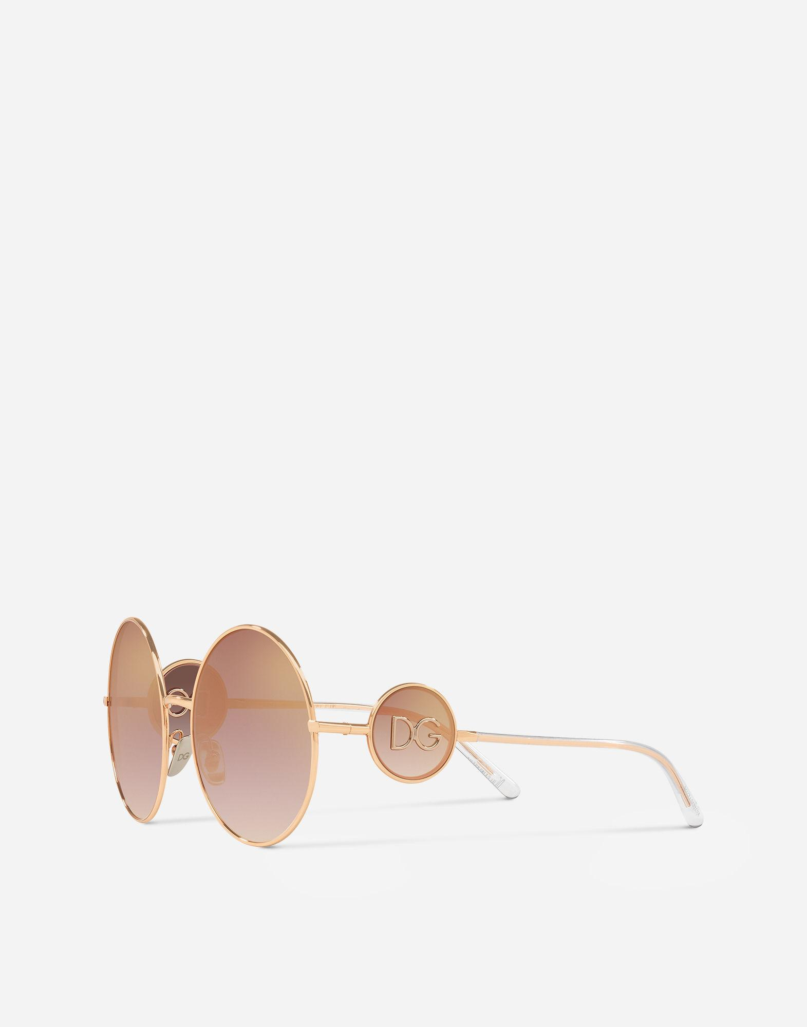 ff388823f4 Lyst - Dolce   Gabbana Round Metal Sunglasses With Dg Logo in Pink