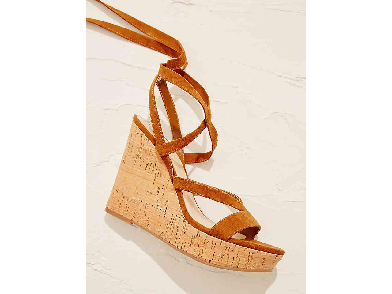 d5cff499970 Lyst - Guess Treacy Wedge Sandal in Brown