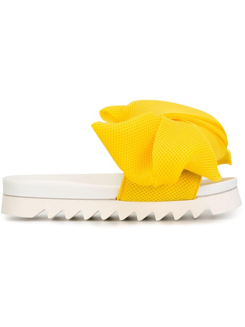 76ba0a9283eb0f Lyst - Joshua Sanders Oversized Bow Slide Sandals in Yellow