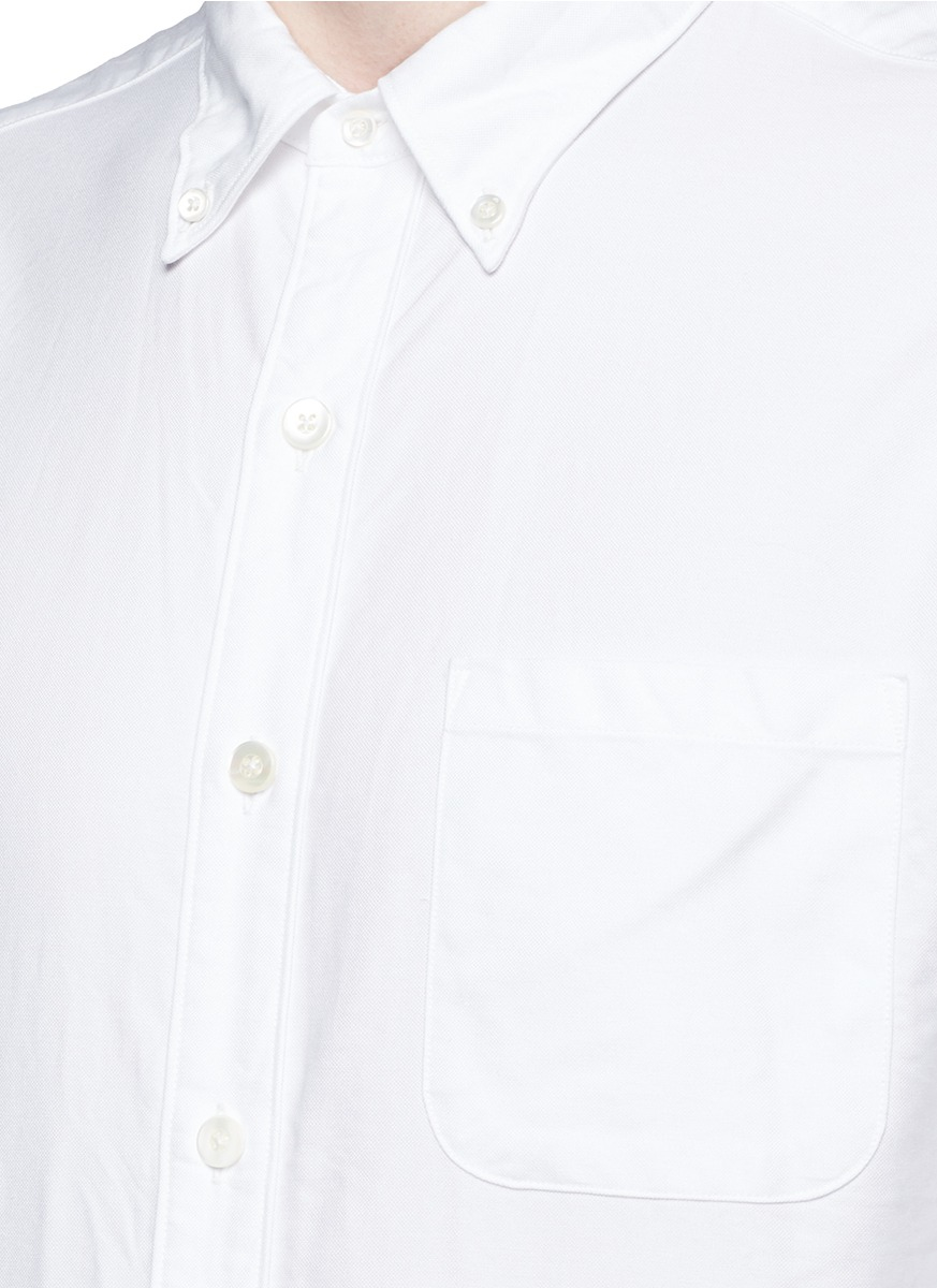 Nanamica button down collar cotton oxford wind shirt in for Button down collar golf shirt