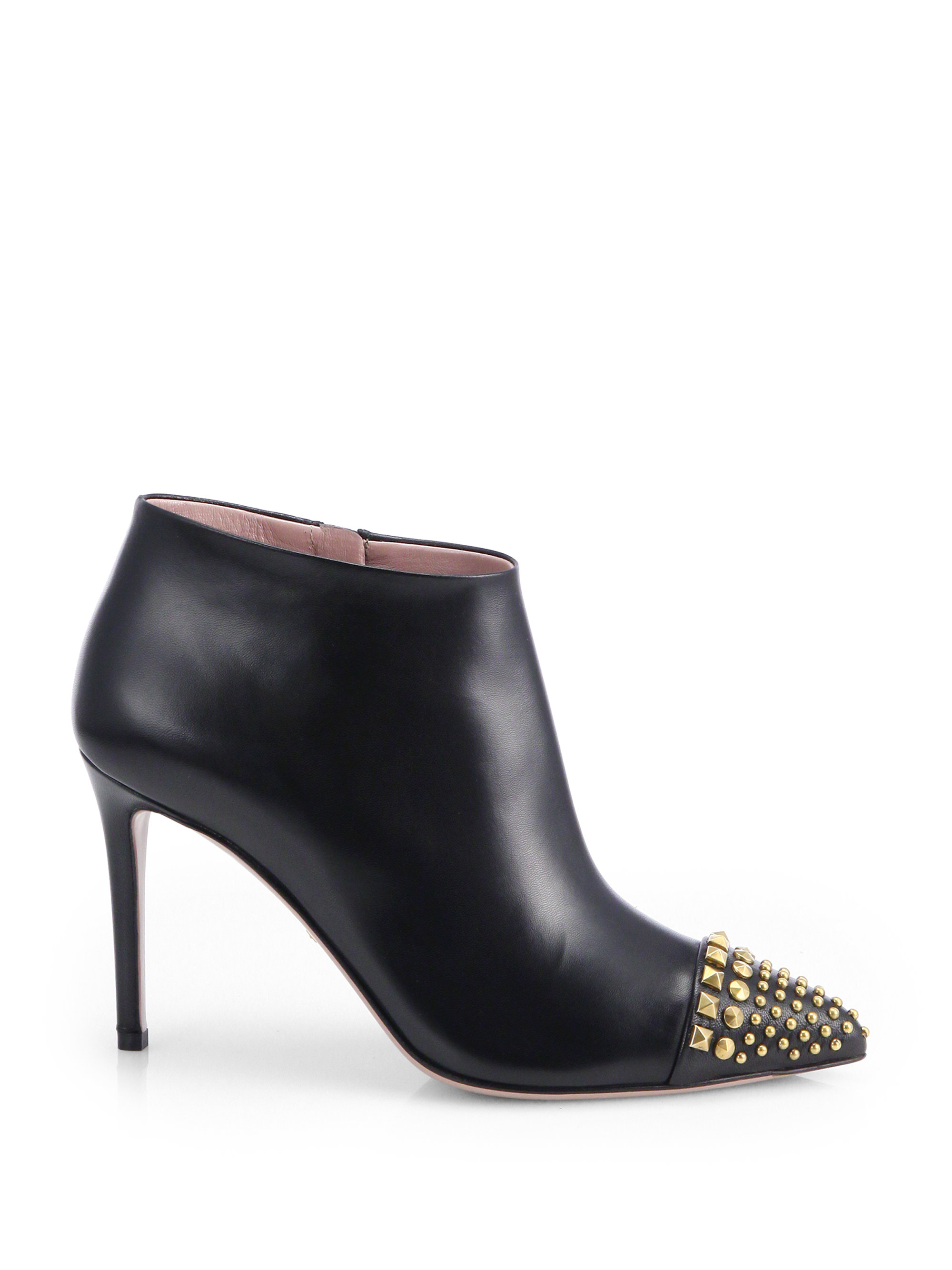 gucci coline studded leather booties in black lyst