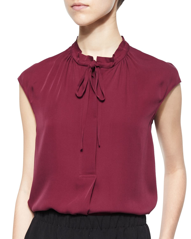 vince silk cap sleeve tie neck blouse in purple bordeaux