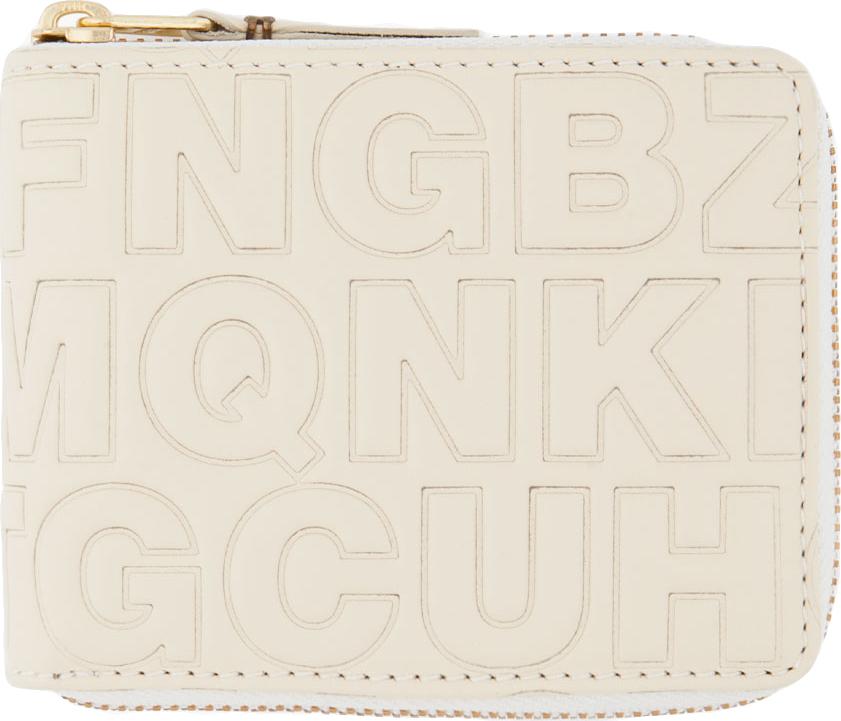 Comme des garcons cream letter embossed wallet in beige for Embossed letters