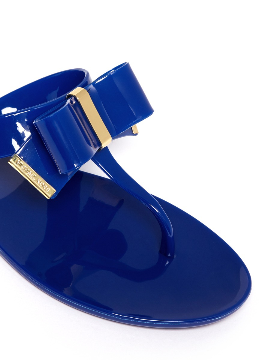 8fd0ef30db3f Michael Kors Kayden Bow Thong Sandals in Blue - Lyst