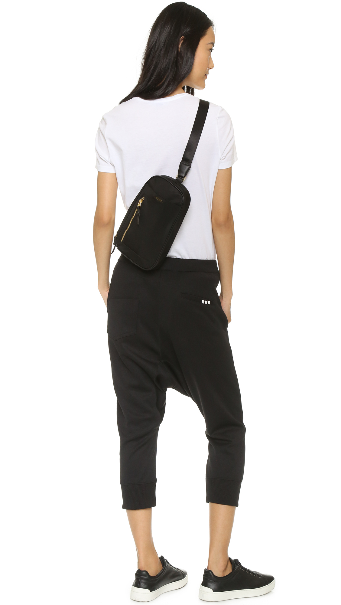 Tumi Mila Small Sling Bag in Black | Lyst