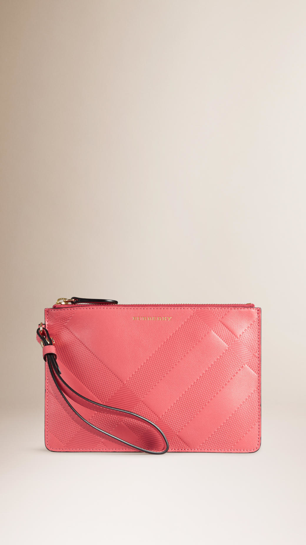 3852f5606ddd Burberry Check Embossed Leather Pouch in Pink - Lyst