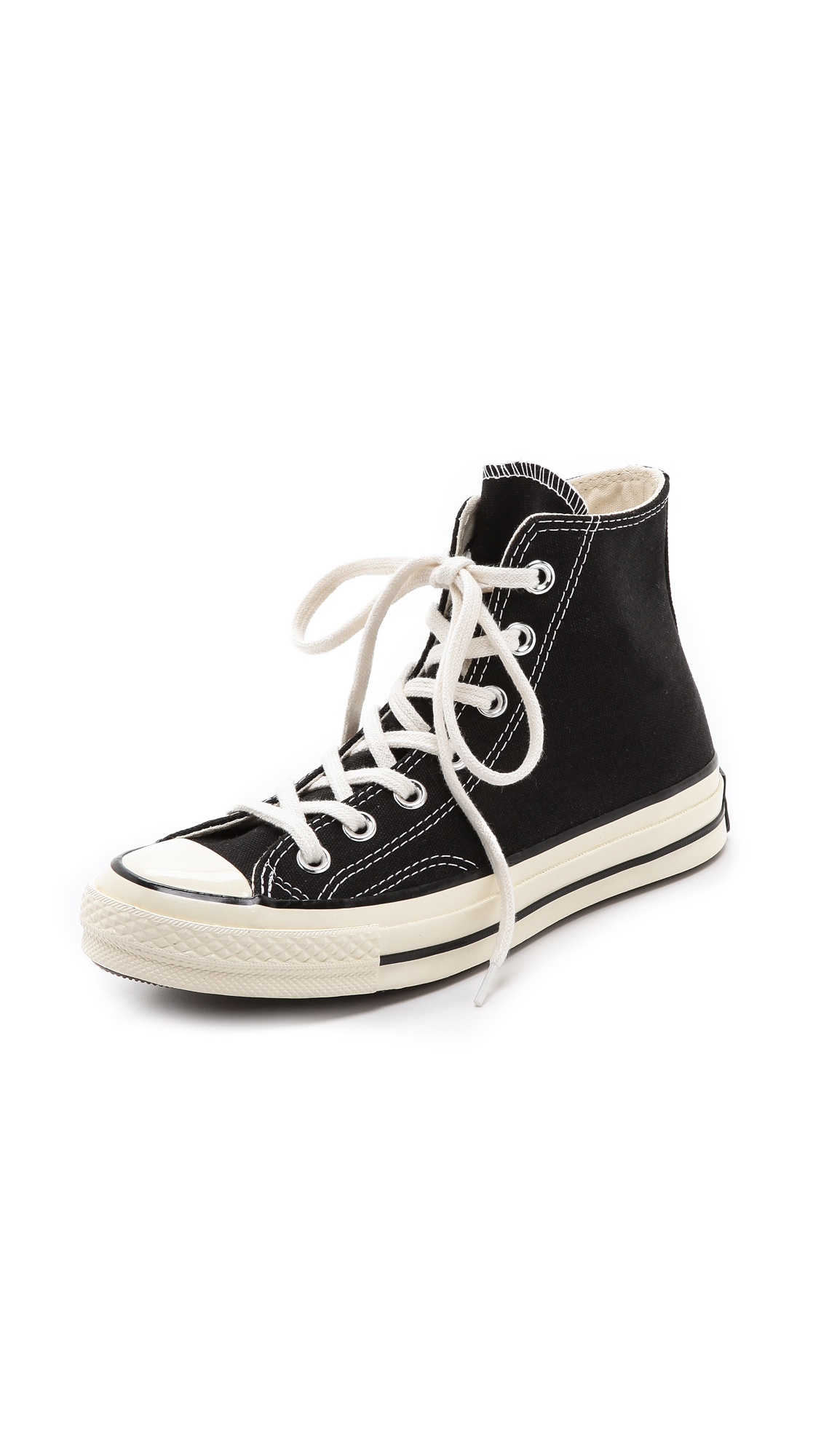 A step above the rest, high top sneakers from luxury shoe makers give special attention to detail in shoes like these. Crafted out of strong materials such as leather, pick a pair in jet black to go with anything in a closet.