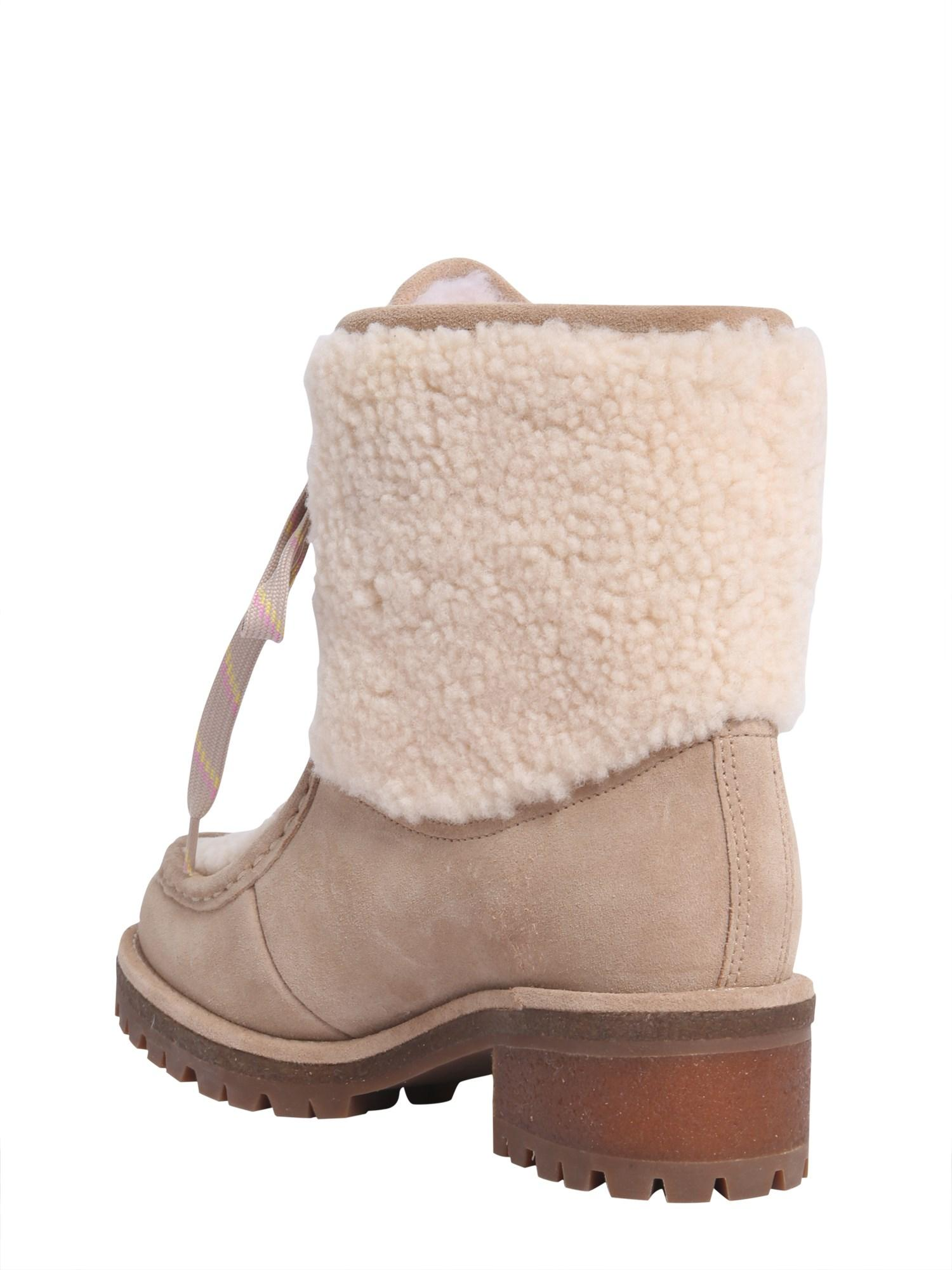 ddcc234ca Lyst - Tory Burch Meadow Shearling And Suede Boots in Natural - Save 24%