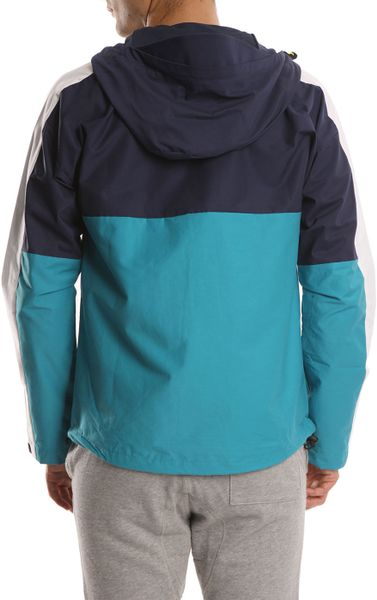 Nike turquoise navy and white windbreaker jacket in blue for Navy blue and white nike shirt