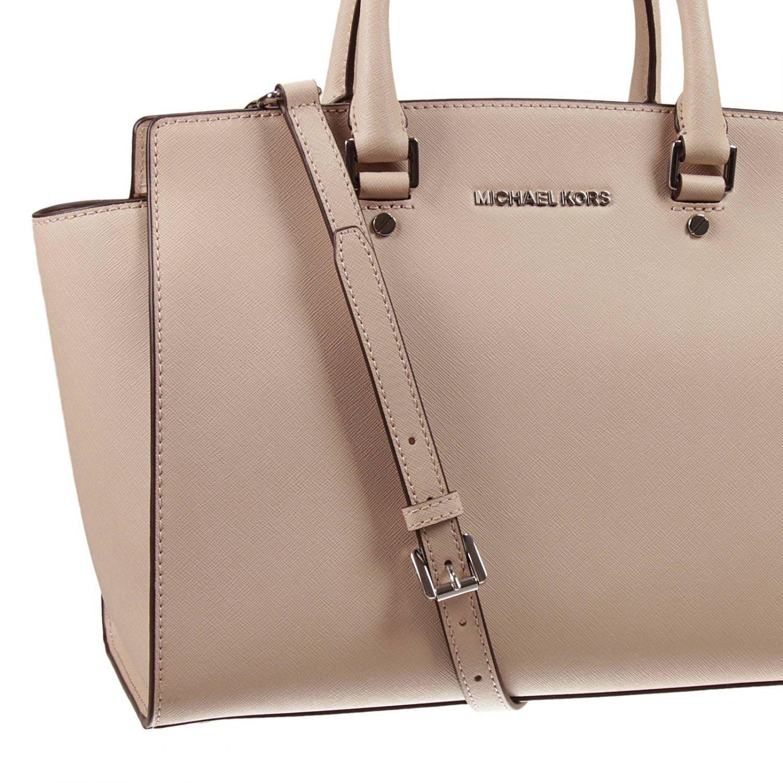 d09c70193519 ... australia lyst michael michael kors handbag in natural 48fae 57f0e